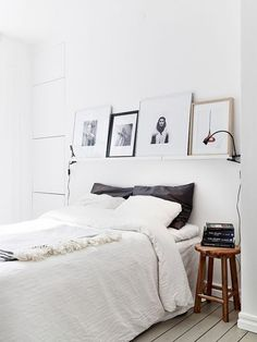 white bedroom, wall steeze - shelves above bed