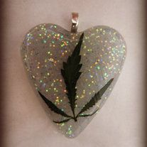 one Real Medical Marijuana Leaf in glitter Resin on Black cord with clasp  Lightweight  *You agree you are over the age of 21 when purchasing   *I do NOT support illegal use of any type of drugs  *legal grown plants  *this necklace is not meant to be broken, the leaf itself will NOT g...