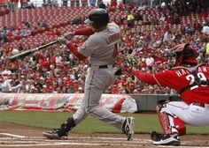 Houston Astros' Jed Lowrie (4) hits an RBI-single off Cincinnati Reds starting pitcher Mat Latos during the first inning of a baseball game on Sunday, April 29, 2012, in Cincinnati. Reds catcher Ryan Hanigan (29)looks on. (AP Photo/David Kohl) game 22