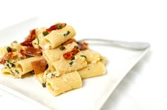 This ought to be called Whitney's Pantry Pasta because it's literally my favorite pantry items all thrown together with some pasta and a creamy, herby white wine sauce.