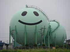 Japanese gas companies occasionally add a touch of character to the giant spherical gas containers that dot the landscape of Japan. Here are a collection of good examples of the cute decorated gas tanks. Street Art, Mood Images, Cute Japanese, Water Tower, Ballon, Oil And Gas, Beautiful Buildings, Urban Art, Landscape