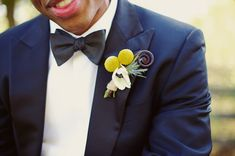 Craspedia Billy Ball Boutonniere | I would probably not add the anemone. The rest is awesome.