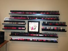 """My creative Ikea """"Nail Polish"""" rack.  This is much prettier than your typical polish rack options. These are Photo Shelves in two different sizes strategically placed.  www.bamboospalkn.com"""