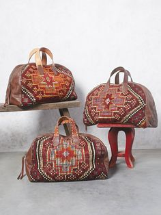 Honeywood Weekender | This super luxe and oh-so soft leather weekender was handmade in Los Angles using antique Turkish weaving techniques with vintage textiles. Vintage tooled belt handles and a zip top closure.
