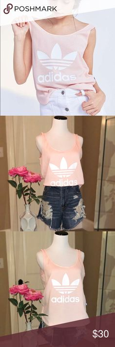 Adidas Originals Loose Tank NWOT!! 💕 Loose silhouette, stamped with trefoil logo on chest. Scooped neck. Boxy, cropped cut. 100% cotton. Mesh-type material. Very breathable for working out, or everyday fashion. adidas Tops Tank Tops