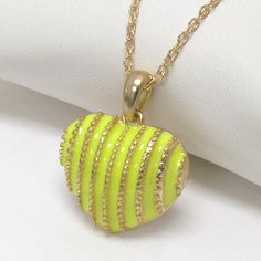FanC Armour - Neon Stripe Puffy Heart Necklace, $8.95 (http://stores.fancarmour.com/neon-stripe-puffy-heart-necklace/)