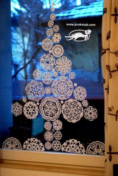Paper snowflakes fir tree for the window - I did this before it looks lovely when the suns setting :)