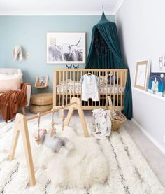 Modern Monty play gym | wooden nursery decor that doubles as a beautiful and safe toy. Our 100% beech wood play gym frame and our hanging toys are safety certified. Check out this incredibly modern, stylish, Scandi nursery. Nursery Inspo!