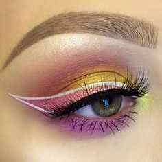 colorful #pink + yellow light #eye #makeup @vanitya + white outlined winged eyeliner