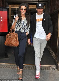 Michelle Keegan.. TFNC Etty Blouse... with loose-fitting navy pants, strappy heels and brown large tote..