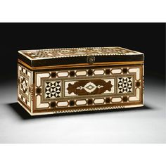 An Ottoman Ivory-Inlaid Scribe's Box, Turkey,17th of rectangular form with detachable cover, inlaid with wood,ivory,ebony,green and red stained ivory,each side with a central foliate ivory cartouche with diamond medallion and palmette terminals reserved on a wood ground,flanked and bordered by geometric trellis and diamond patterning surrounded by polygonal bands of alternating ebony and ivory,the cover with green and red stained ivory plaques and filaments,the front with a later repoussé…