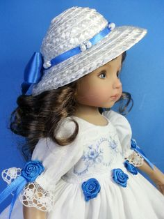 "Made by Salstuff to fit 13"" dolls such as Little Darling and Maru Mini Pal. Lovely soft layered dress and hat with an extra touch of luxury.  Delicate embroidered organza panels and blue satin ribbon roses.  https://www.facebook.com/sally.channon"