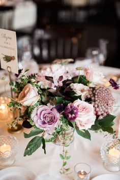 Spring wedding centerpiece in eggplant, taupe, and blush. Photo by T&C Photographie, tandcstudios.com || Flowers by Pollen, pollenfloraldesign.com