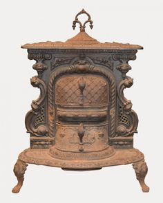VICTORIAN EMPIRE GRATE NO. 1 CAST IRON PARLOR STOVE, E. Bachus, New York; patented 1858; height: 35 inches, width: 24 inches