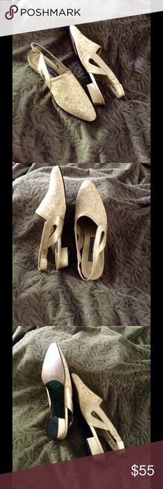 VINTAGE Stuart Weitzman cork shoes These shoes are so simple yet chic! They are vintage but in like new condition!Leather soles with cork shavings on the top..The last pic shows the wonderful condition of the bottoms. These have a small one inch heel and can dress any outfit up or down! Very unique but perfectly on trend! Size 7 but I believe these could fit anywhere from 6-7 Stuart Weitzman Shoes