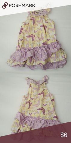 Savannah dress Beautiful no sleeve yellow and purple butterfly dress. Three tiers of ruffles on the bottom Savannah Dresses Casual