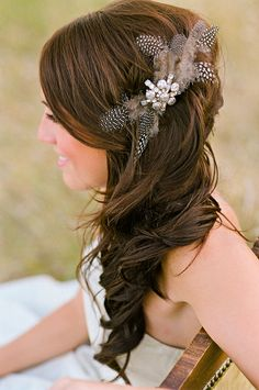 side wedding hair. I dont like the weird feather thing but the basic hairstyle is classy and cute
