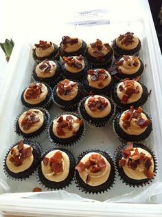 bacon cupcakes - dense german chocolate brownie style cupcake, stuffed with bacon jam, frosted with salted caramel buttercream and garnished with candied bacon pieces.