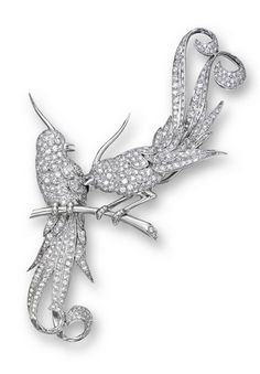 DIAMOND 'BIRD' DOUBLE-CLIP BROOCH, CIRCA 1930 Designed as two fanciful lovebirds perching on a branch, the bodies pavé-set throughout with single-cut diamonds together weighing approximately 6.00 carats, mounted in platinum, detachable to form two clips.