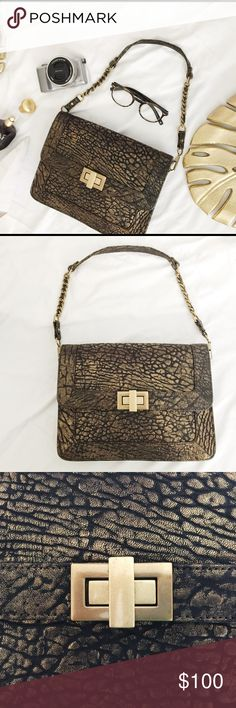 REBECCA MINKOFF • gold and black purse Gently used condition. Minor signs of wear but nothing is noticeable. Gold vintage inspired hardware. Chain straps. Black and white liners. Unique and edgy. No trade. Thanks for looking. Rebecca Minkoff Bags Shoulder Bags