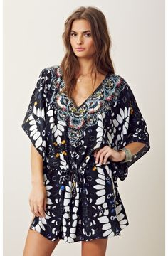 Cute dress, would be a cuter swimsuit cover up :)
