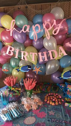 Mermaid party decorations Coral sticks  Star fish rice crispies  Chocolate covered pretzel sticks  Fish net back drop  Pearly balloons Clam nilla cookies with sixlet pearl