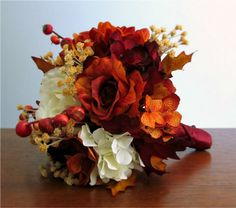 Autumn Silk Flower Wedding Bouquets in Ivory, Burnt Orange, and Burgundy with Roses, Hydrangea, Dahlias, Gypsophila, Rose Hip Berries and Fall Leaves #PosiesPearls