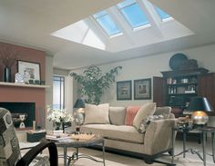 Skylights in living room. Flat ceiling with attic.