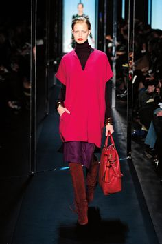 Diane Von Furstenberg's Fall 2011 Collection is perhaps the best entire collection I've ever seen. This look made me fall in love with mixing the colors Burgundy, Magenta, and Purple. And these boots. Love me some DVF.