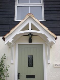 Timber door canopies - traditional cottage canopies - front door canopiesTimber door canopies - traditional cottage canopies - front door canopiesMetal Door Canopy TYPE: L DDA Act CompliantMetal Door Canopy - DDA CompliantI would like Porch Uk, Front Door Porch, Wooden Front Doors, Timber Door, House With Porch, House Front, Front Door With Canopy, Front Door Overhang, Front Door Entrance