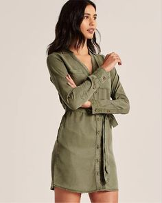 Shirt dress with removable tie belt, pockets throughout and adjustable button-sleeve. Jumpsuit Dress, Shirt Dress, Dress Shirts For Women, Belt Tying, Abercrombie Fitch, Me Too Shoes, Military Jacket, Tie, Shorts