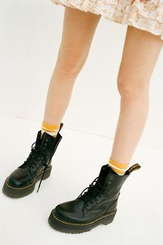 An icon reimagined with fiercely punk-inspired details in this platform iteration of Dr. Martens' classic 8-eye combat boot. Smooth leather boot cut above ankle with an 8-eye lace-up closure and back pull tab. With their air-cushioned sole with top-stitch detailing complete with cotton laces, metal eyelets and a slightly raised heel. Finished with their signature slip-resistant rubber sole in a towering platform with iconic yellow stitching.Content + Care. #drmartensboots