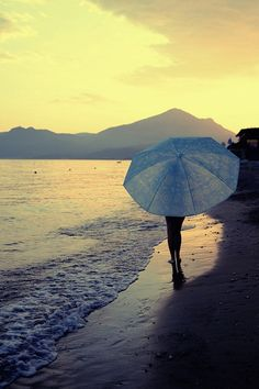 Umbrella at sundown on a beach