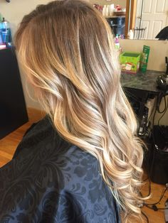 Honey blonde balayage hair blended