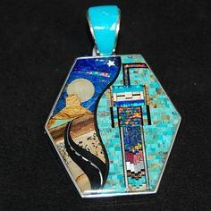 Sterling Silver pendant by Navajo artist, David R. Freeland, Jr.  Storyteller pendant has inlay of Turquoise, Picture Jasper, Black Onyx, Mother of Pearl, Coral, and Lab Opal. Road of the Southwest and Spirit God is depicted.