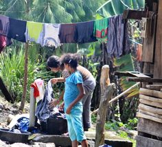 Woman washing clothes in a village in Mindanao