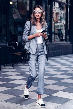 20+ Fresh & Chic Summer Work Outfits: Fashion blogger 'Viva Luxury' wearing a grey blazer, grey crop pants, a white cami top, white cap toe oxfords, white cat eye sunglasses and a black shoulder bag. Work outfits, summer work outfits, outfits for work, office outfits, office wear, simple work outfits, work outfits 2017, spring work outfits, comfy work outfits. Suits And Sneakers, Sneakers To Work, Summer Work Outfits, Office Outfits, Office Ootd, Work Wear Office, Fall Outfits, Fashion Outfits, Womens Fashion