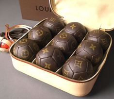Louis Vuitton Tennis Balls, a wonderful pinner just informed me what these proposed tennis balls may truly be...these are Indoors Petanque Balls (a French game) see for yourself http://www.discoverfrance.net/France/Sports/DF_boules.shtml