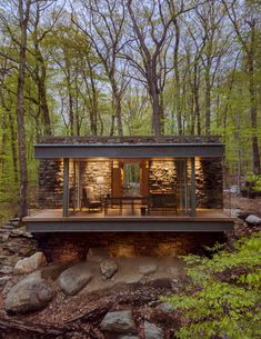 """American architect Eric J Smith has used stone, oak and glass in this poet's writing studio, to """"reinforce its sense of belonging"""" in the Connecticut woods. Writing Studio, Casas Containers, Wooden Staircases, Tiny House Cabin, Tiny Cabins, House Extensions, Cabins In The Woods, Architecture Design, Architecture Drawings"""