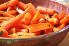 2 Lbs. Frozen Baby Carrots  2 to 4 Tbs Margarine, 2 to 3 Tbls. Honey, 2-3 Tbls. Brown Sugar, 1 Tsp. Cinnamon.  Steam frozen carrots for 10-15 minutes until cooked through, but not mushy; drain; melt the margarine in a skillet; add the cooked carrots, along with the honey, brown sugar, and cinnamon; cook for approximately 10 minutes; serve warm. Serves 6.