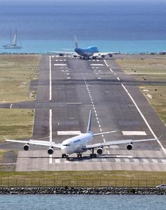 KLM 747 prepares to circle around and wave goodbye to Maho Beach spectators, while the Air France A340 prepares to circle back and head to the terminal ... at St. Maarten's Princess Juliana Airport (SXM)