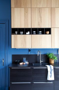 Blue kitchen, wood cabinets