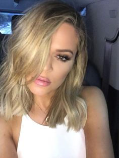 Kardashian chopped off her long locks and debuted this shorter style, chopped by friend and hairstylist Jen Atkin, at her sister Kim's baby shower.    - ELLE.com