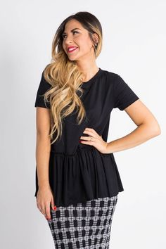 Little black relaxed ruffle tee!  This ruffle defines your waist and flows gracefully over your hips.  Dress it up, dress it down!