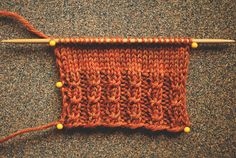 mock cables rib. The effect is created by a twisted stitch once every 4 rows. No cable needle needed!  Multiple of 4 + 2  RT (right twist): Knit into the second stitch on the left needle, do NOT drop. Knit into the first stitch, as usual, drop BOTH stitches.  Rows 1 and 3 (WS): K2, *P2, K2; Repeat from * to end of row. Row 2: P2, *RT, P2; Repeat from * to end of row. Row 4: P2, *K2, P2; Repeat from * to end of row. Repeat Rows 1-4 for pattern.
