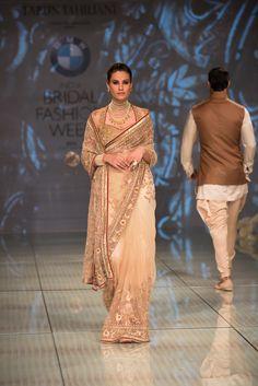 Tarun Tahiliani gold mother of the bride or groom sari. More here: http://www.indianweddingsite.com/bmw-india-bridal-fashion-week-ibfw-2014-tarun-tahiliani-show/