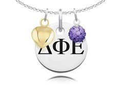 "Delta Phi Epsilon Greek Letters High Quality Necklace with Heart and Crystal Ball Charms  Solid Sterling Silver  Standard Chain Length is 16""  Circle Charm Size is 17mm (size of a dime)  Crystal Ball Measures 5mm in Diameter  #College #Jewelry #DeltaPhiEpsilon #SterlingSilver #CrystalBall #Gold #Heart #Charm"
