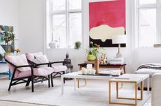 The deep pink in the painting, bought at an art market, ties the living room scheme together, echoing the rosy hue in the freshly upholstered armchairs, which were secondhand buys. Photo: Martin Solyst   Story: real living
