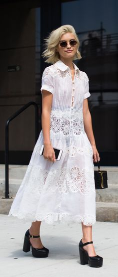 This white silk pleated dress from Rochas is the ultimate summer dress. Explore the latest new season arrivals on Farfetch.