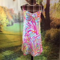 "NWT Lilly Pulitzer Dusk Strappy Silk Slip Dress XL Brand new. Never been worn. Lilly Pulitzer Dusk Strappy Silk Slip Dress. Size XL. Resort White. Scuba to Cuba. Fully lined. Dry clean. B. 21.5""  L. 18"" from natural waist to hem. Please ask questions before buying. No trades. No PayPal. Lilly Pulitzer Dresses Mini"
